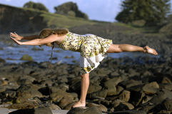 Yoga lady 01. A beautiful young woman practices yoga on a the beach Stock Image