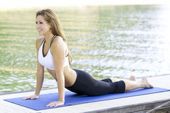 Yoga on the lake. Yoga performed on a dock by the lake Royalty Free Stock Images