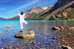 Yoga on the lake Royalty Free Stock Photos