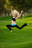 Yoga leap in the park Stock Photos