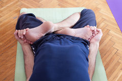 Yoga leg twist Royalty Free Stock Image