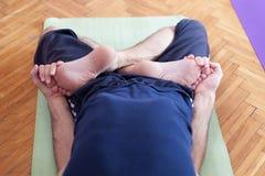 Yoga leg twist Royalty Free Stock Image