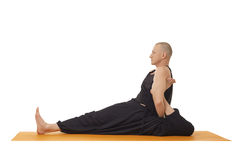 Yoga lessons. Flexible man posing at camera Royalty Free Stock Photos