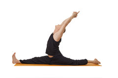 Yoga lessons. Middle aged man exercising in studio Stock Photography