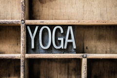 Yoga Letterpress Type in Drawer. The word YOGA written in vintage metal letterpress type sitting in a wooden drawer Royalty Free Stock Images