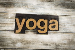 Yoga Letterpress Word on Wooden Background Royalty Free Stock Photos