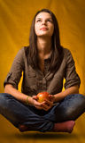 Yoga levitation with apple. Royalty Free Stock Photography