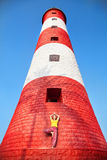 Yoga at lighthouse Stock Photo