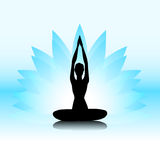 Yoga-lotus. Female silhouette on the blue lotus background Royalty Free Stock Photos