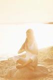 Yoga lotus meditation. Silhouette of woman in yoga lotus meditation position front to seaside Stock Photos