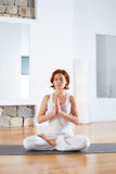Yoga Lotus pose meditation in wooden floor Royalty Free Stock Photo