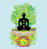 Yoga lotus pose. Padmasana with colored chakra points. Royalty Free Stock Image