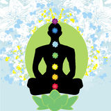 Yoga lotus pose. Padmasana with colored chakra points. Royalty Free Stock Photography