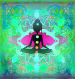 Yoga lotus pose. Padmasana with colored chakra points. Stock Photography