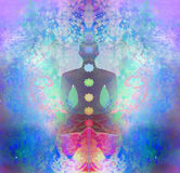 Yoga lotus pose. Padmasana with colored chakra points. Stock Photo