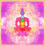 Yoga lotus pose. Padmasana with colored chakra points. Royalty Free Stock Images