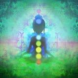 Yoga lotus pose. Padmasana with colored chakra points. Royalty Free Stock Images