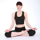 Yoga lotus pose padmasana by fit young woman Stock Photography