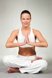 Yoga - Lotus seat. Young woman in a yoga position (Lotus seat Stock Image