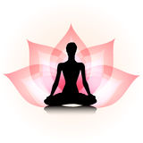 Yoga-lotus. Woman silhouette on the lotus background Stock Photography