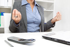 Yoga at lunch. Business woman meditating yoga at lunch in office Royalty Free Stock Photography