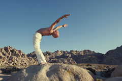 Yoga Man. Man in yoga posture outdoors in the open desert Royalty Free Stock Image