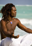 Yoga man in cuba. Yoga black man on the beach over blue sea and grey sky Royalty Free Stock Photos
