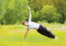 Yoga man doing exercise outdoors Royalty Free Stock Image