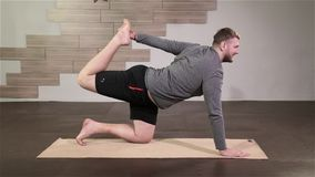 Yoga Man Doing Flexible Exercise In The Sport Gym stock footage