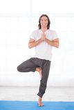 Yoga man doing tree pose Royalty Free Stock Photography