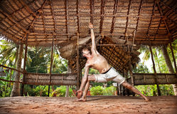 Yoga man in Indian shala Royalty Free Stock Photo