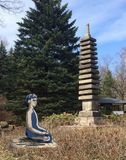 Yoga. man meditating next to the pagoda, harmony royalty free stock images