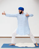 Yoga. Man performing archer pose Stock Image