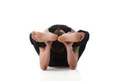 Yoga Man posing in studio Stock Photography