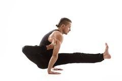 Yoga Man posing in studio Stock Images