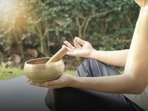 Yoga man with singing bowl for meditation royalty free stock images
