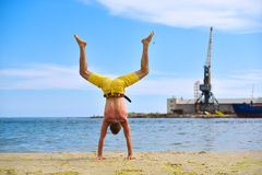 Yoga man standing on hands Royalty Free Stock Photos