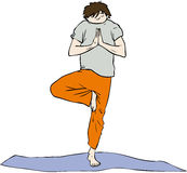 Yoga man. Man standing on a mat in a yoga pose Stock Photos