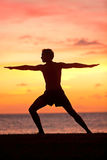 Yoga man training and meditating in warrior pose Royalty Free Stock Images