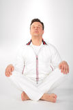 Yoga man in white sportswear Royalty Free Stock Photos