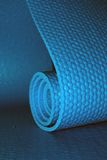 Yoga mat. Close up of a yoga mat, half rolled, half open Royalty Free Stock Photos