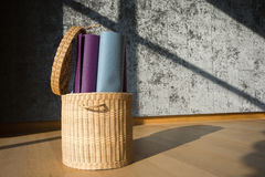 Yoga mat in the basket Royalty Free Stock Images