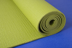 Yoga Mat on Blue Stock Photo