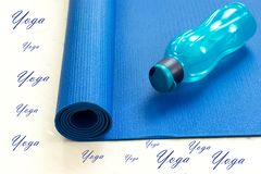Yoga mat and water bottle stock photo
