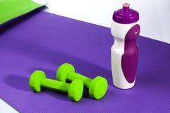 Yoga mat, bottle, dumbbells Stock Photo