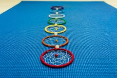 Yoga mat and chakra symbol stock images