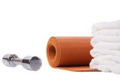 yoga mat, dumbbell, towel Stock Image