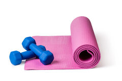 Yoga mat and dumbbells Royalty Free Stock Image