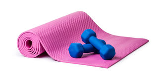 Yoga mat and dumbbells Royalty Free Stock Photo