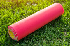 Yoga mat on the grass. At sunset stock photos